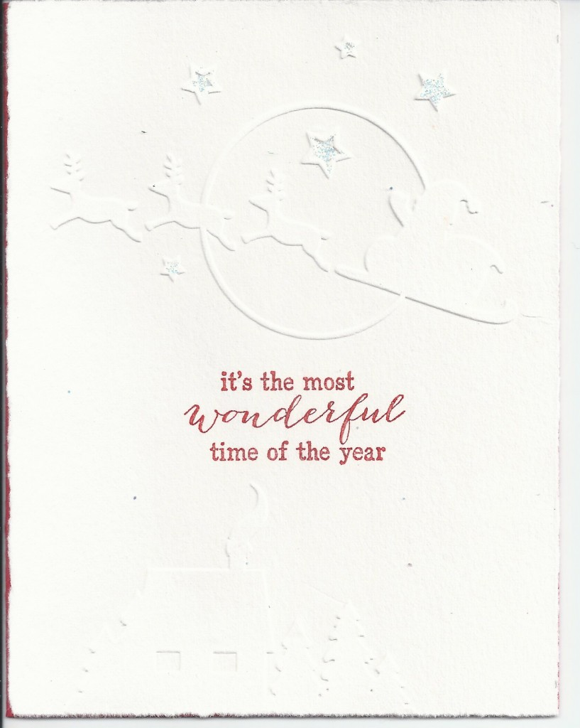 Merrilyn Shape dry embossed image on white card with stamp