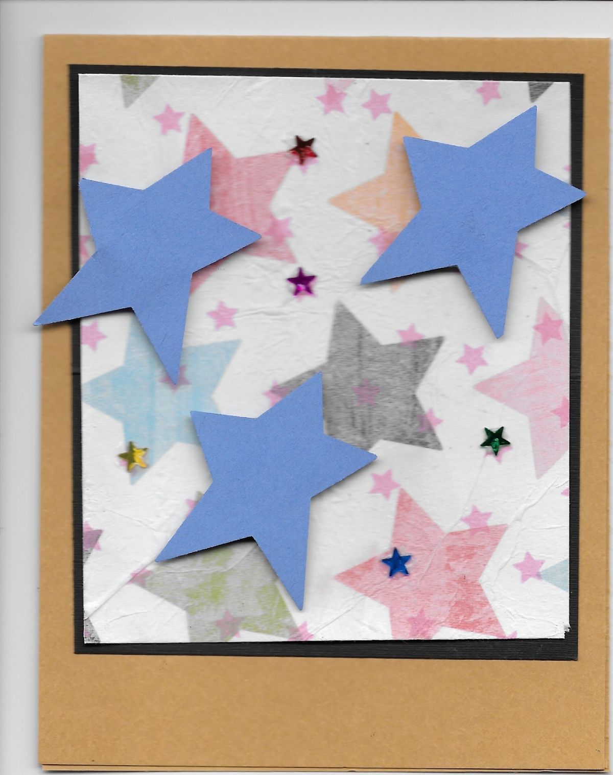 This is my version using star printed paper and tissue paper with stars then  tiny star confetti on top..