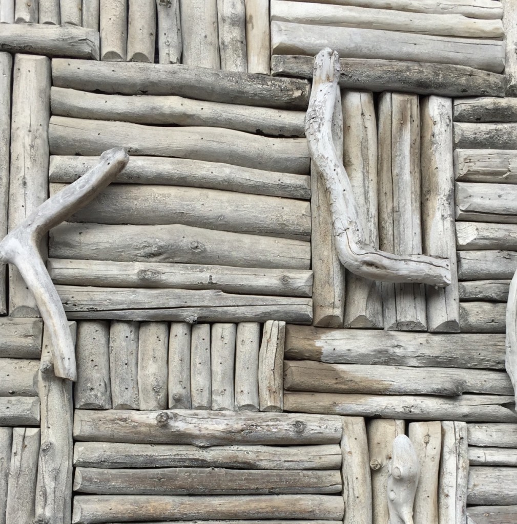 close up of driftwood decor on outside of building